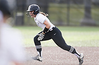Bentonville second baseman Emily Perry (20) slides to third, Thursday, April 29, 2021 during a softball game at Bentonville High School in Bentonville. Check out nwaonline.com/210430Daily/ for today's photo gallery. <br /> (NWA Democrat-Gazette/Charlie Kaijo)