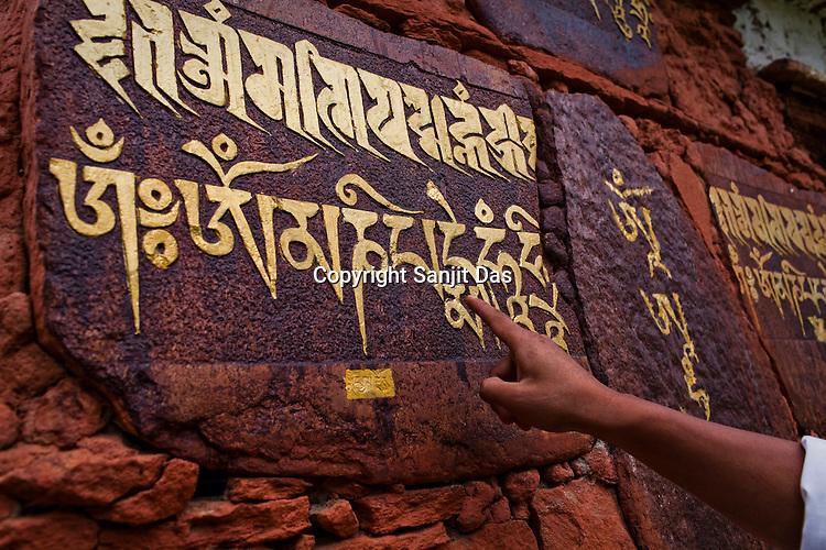 Sanskrit and Bhutanese religious inscriptions are seen on walls in Paro, Bhutan. Photo: Sanjit Das/Panos