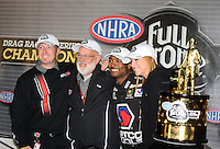 Nov. 11, 2012; Pomona, CA, USA: NHRA top fuel dragster driver Antron Brown celebrates with crew after winning the 2012 championship during the Auto Club Finals at at Auto Club Raceway at Pomona. Mandatory Credit: Mark J. Rebilas-
