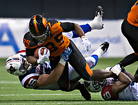 Vancouver, September, 09, 2016 - Lions' Shaquille Murray-Lawrence[L] is taken down by Alouette Jeffrey Finley.The Montreal Alouettes lost to the BC Lions 27-38. (Andrew Soong)