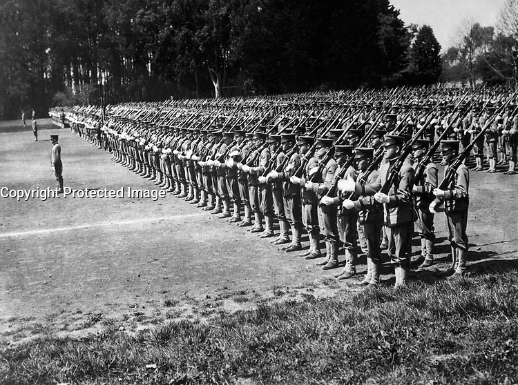 Activity in the ranks of University of California unit.  Photo shows California students inspection drill on the University Campus at Berkeley, Calif.  Ca.  1917-18.  IFS.  (War Dept.)<br />Exact Date Shot Unknown<br />NARA FILE #:  165-WW-115A-1<br />WAR & CONFLICT BOOK #:  456