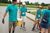 """Thomas Franco, center, talks with fellow members during """"Circle the City with Service,"""" the Kiwanis Circle K International's 2015 Large Scale Service Project, on Wednesday, June 24, 2015, in Indianapolis. (Photo by James Brosher)"""