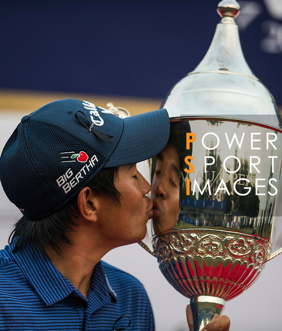 Pavit Tangkamolprasert of Thailand kisses the trophy after winning the Venetian Macao Open 2016 at the Macau Golf and Country Club on 16 October 2016 in Macau, China. Photo by Marcio Machado / Power Sport Images