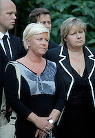 """(Oslo July 27, 2011)  Siv Jensen (Progress Party) listens with other politicians as PM Jens Stoltenberg announced the creation of a """"22 July Commission"""" to investigate Friday's bomb and gun attacks...A large vehicle bomb was detonated near the offices of Norwegian Prime Minister Jens Stoltenberg on 22 July 2011. .Another terrorist attack took place shortly afterwards, where a man killed 68 people, mainly children and youths attending a political camp at Utøya island. ..Anders Behring Breivik was arrested on the island and has admitted to carrying out both attacks..(photo:Fredrik Naumann/Felix Features)"""