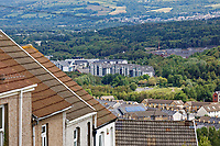 Pictured: One of the recent housing developments seen over roofs of houses in Waun Wen in the Mayhill area of Swansea, Wales, UK. Wednesday 16 June 2021<br /> Re: Riot aftermath in the Mayhill area of Swansea, Wales, UK.