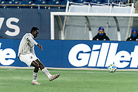 FOXBOROUGH, MA - NOVEMBER 20: Mustafa Kizza #12 of Montreal Impact passes the ball during the Audi 2020 MLS Cup Playoffs, Eastern Conference Play-In Round game between Montreal Impact and New England Revolution at Gillette Stadium on November 20, 2020 in Foxborough, Massachusetts.