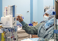 LOS ANGELES (April 2, 2020) Lt. Cmdr. Trevares Baker, from Pensacola, Fla., a certified registered nursing anesthetist, prepares equipment prior to a surgery in one of 12 operating rooms aboard the hospital ship USNS Mercy (T-AH 19) April 2. Mercy deployed in support of the nation's COVID-19 response efforts, and will serve as a referral hospital for non-COVID-19 patients currently admitted to shore-based hospitals. This allows shore base hospitals to focus their efforts on COVID-19 cases. One of the Department of Defense's missions is Defense Support of Civil Authorities. DoD is supporting the Federal Emergency Management Agency, the lead federal agency, as well as state, local and public health authorities in helping protect the health and safety of the American people<br />