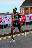 3rd October 2021; London, England: The Virgin Money 2021 London Marathon: Shura Kitata of Ethiopia crossing Narrow Street Swing Bridge, Limehouse Basin between mile 14 and 15.