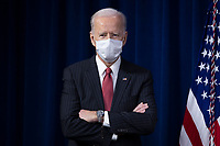 US President Joe Biden prepares to deliver remarks to Department of Defense personnel, at the Pentagon in Arlington, Virginia, USA, 10 February 2021.<br /> CAP/MPI/RS<br /> ©RS/MPI/Capital Pictures