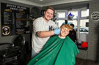 Pictured: Kees De Boer gets a hair cut from Jonny Hamford, Owner of Jonny blades barber shop in Morriston, Swansea Wales, UK. Wednesday 04 September 2019