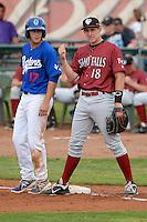Ogden Raptors Jake Chaplin #17 and Idaho Falls Chukars Frank Schwindel #18 in action at Lindquist Field on June 23, 2013 in Ogden, Utah. (Stephen Smith/Four Seam Images)