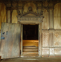 The elaborately carved doorway from the Long Gallery to the anteroom of the State Bedroom