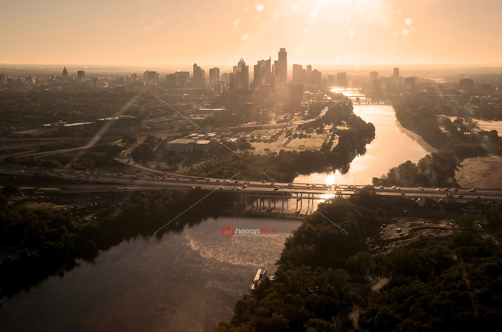Aerial birdseye view from a helicopter of the downtown Austin skyline, Lady Bird Lake and Mopac highway interchange during morning rush hour traffic.