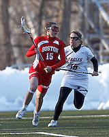 Boston University midfielder Ally Adams (15) on the attack as Boston College defender Molly Erdle (16) closes..Boston College (white) defeated Boston University (red), 12-9, on the Newton Campus Lacrosse Field at Boston College, on March 20, 2013.