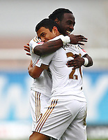 Jefferson Montero of Swansea celebrates scoring the opening goal with team-mate Marvin Emnes of Swansea   during the Emirates FA Cup 3rd Round between Oxford United v Swansea     played at Kassam Stadium  on 10th January 2016 in Oxford