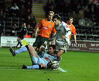 ATTENTION SPORTS PICTURE DESK<br /> Pictured: Jordi Gomez of Swansea (R) is toppled over by Romain Larrieu, goalkeeper for Plymouth Argyle (on the ground) which earned the former's team a penalty scored by Jason Scotland (not pictured).<br /> Re: Coca Cola Championship, Swansea City FC v Plymouth Argyle at the Liberty Stadium, Swansea, south Wales. 10 March 2009.<br /> Picture by D Legakis Photography / Athena Picture Agency, Swansea 07815441513