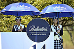 JEJU, SOUTH KOREA - APRIL 24: Hostesses  hold umbrellas on the 14th tee during the Round Two of the Ballantine's Championship at Pinx Golf Club on April 24, 2010 in Jeju island, South Korea. Photo by Victor Fraile / The Power of Sport Images