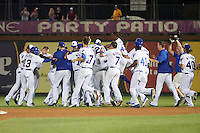 South Bend Cubs Carlos Sepulveda (2) is mobbed by teammates, including Bryant Flete (13), Preston Morrison (19), Matt  Rose (17), John Williamson (20), P.J. Higgins (7), Roberto Caro (43), and Kyle Miller (40), after a walk off hit during a game against the Burlington Bees on July 22, 2016 at Four Winds Field in South Bend, Indiana.  South Bend defeated Burlington 4-3.  (Mike Janes/Four Seam Images)