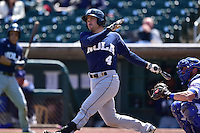 Vinny Rottino (4) of the New Orleans Zephyrs swings at pitch against the Iowa Cubs at Principal Park on April 23, 2015 in Des Moines, Iowa.  The Zephyrs won 9-2.  (Dennis Hubbard/Four Seam Images)