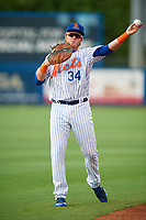 St. Lucie Mets first baseman Dash Winningham (34) warms up before the first game of a doubleheader against the Charlotte Stone Crabs on April 24, 2018 at First Data Field in Port St. Lucie, Florida.  St. Lucie defeated Charlotte 5-3.  (Mike Janes/Four Seam Images)