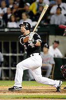 August 7, 2009:  Second Baseman Jayson Nix (5) of the Chicago White Sox follows through on a hit during a game vs. the Cleveland Indians at U.S. Cellular Field in Chicago, IL.  The Indians defeated the White Sox 6-2.  Photo By Mike Janes/Four Seam Images