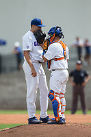 Florida Gators catcher Mike Rivera (4) has a chat on the mound with starting pitcher Alex Faedo (21) during the game against the Wake Forest Demon Deacons in Game One of the Gainesville Super Regional of the 2017 College World Series at Alfred McKethan Stadium at Perry Field on June 10, 2017 in Gainesville, Florida.  The Gators defeated the Demon Deacons 2-1 in 11 innings.  (Brian Westerholt/Four Seam Images)