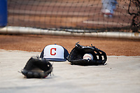 Cleveland Indians hat and gloves on the field during practice before Game 3 of the Major League Baseball World Series against the Chicago Cubs on October 28, 2016 at Wrigley Field in Chicago, Illinois.  (Mike Janes/Four Seam Images)