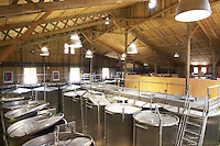 Domaine de l'Hortus. Pic St Loup. Languedoc. The winery building. Stainless steel fermentation and storage tanks. Floating top vats. France. Europe.