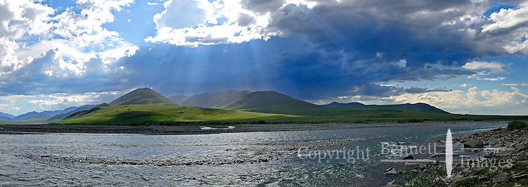 A thunder storm passes over the mountains along the Kongakut River, in Alaska's Arctic National Wildlife Refuge.