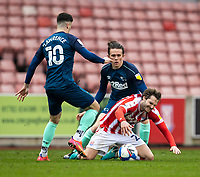 20th March 2021; Bet365 Stadium, Stoke, Staffordshire, England; English Football League Championship Football, Stoke City versus Derby County; Nick Powell of Stoke City is tackled by Tom Lawrence of Derby County
