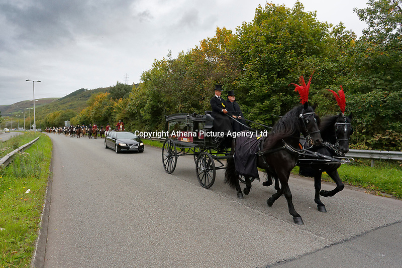 """Pictured: The funeral cortege approaches Margam Crematorium, Wales, UK. Monday 08 October 218<br /> Re: A grieving father will mourners on horseback at the funeral of his """"wonderful"""" son who killed himself after being bullied at school.<br /> Talented young horse rider Bradley John, 14, was found hanged in the school toilets by his younger sister Danielle.<br /> Their father, farmer Byron John, 53, asked the local riding community to wear their smart hunting gear at Bradley's funeral.<br /> Police are investigating Bradley's death at the 500-pupils St John Lloyd Roman Catholic school in Llanelli, South Wales.<br /> Bradley's family claim he had been bullied for two years after being diagnosed with Attention Deficit Hyperactivity Disorder.<br /> He went missing during lessons and was found in the toilet cubicle by his sister Danielle, 12."""