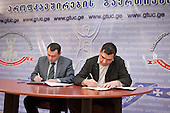 Signing of agreement between the Georgian transport trade union and representatives of five companies who have won the contract to run Tbilisi's microbus service.