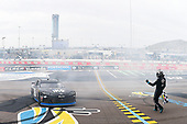 #18: Kyle Busch, Joe Gibbs Racing, Toyota Supra Extreme Concepts/iK9, does a burnout after winning