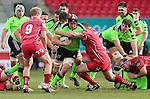 Scarlets hooker Ken Owens tackles Munster flanker Tommy O'Donnell.<br /> Guiness Pro12<br /> Scarlets v Munster<br /> 21.02.15<br /> ©Steve Pope -SPORTINGWALES