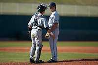 Xavier Musketeers catcher Nate Soria (5) talks with pitcher Sam Czabala (18) at the mound against the Penn State Nittany Lions at Coleman Field at the USA Baseball National Training Center on February 25, 2017 in Cary, North Carolina. The Musketeers defeated the Nittany Lions 10-4 in game one of a double header. (Brian Westerholt/Four Seam Images)