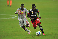 WASHINGTON, DC - SEPTEMBER 12: Mohammed Abu #25 of D.C. United battles for the ball with Dru Yearwood #16 of New York Red Bulls during a game between New York Red Bulls and D.C. United at Audi Field on September 12, 2020 in Washington, DC.
