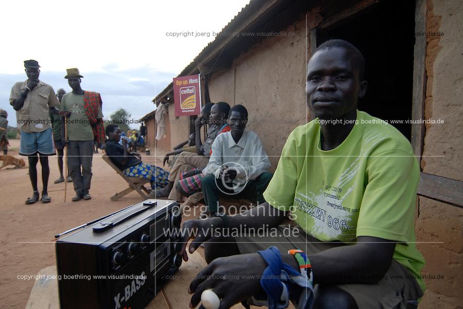 UGANDA Karamoja , Karimojong a pastoral tribe , man with Chinese radio X-Bass / Uganda Karamoja , Volk der Karimojong , Mann mit chinesischem Radio X Bass