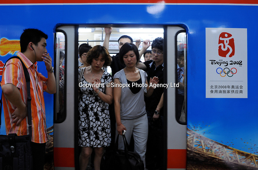 Commuters on the Beijing underground..02 Jul 2008