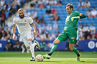 3rd October 2021;  RCDE Stadium, Barcelona, Spain: La Liga Football, Espanyol versus Real Madrid; <br /> Diego Lopez of RCD Espanyol clears from Benzema during the Liga match between RCD Espanyol and Real Madrid at RCDE Stadium in Cornella, Spain.