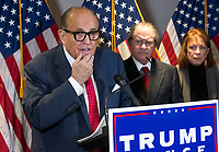 Former Mayor Rudy Giuliani (Republican of New York, New York) conducts a press conference at Republican National Committee headquarters in Washington, DC on Thursday, November 19, 2020.  He is accompanied by Trump Campaign Senior Legal Advisor Jenna Ellis.<br /> Credit: Rod Lamkey / CNP /MediaPunch