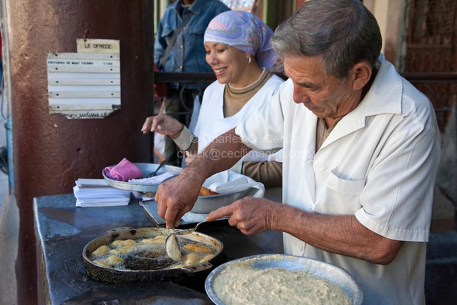 Cuba, Havana.  Street Food Vendors Frying Pastries.