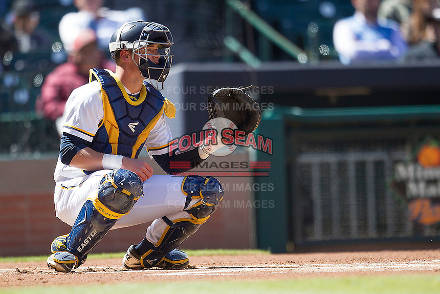 California Golden Bears catcher Andrew Knapp #5 on defense against the North Carolina Tar Heels in the NCAA baseball game on March 2nd, 2013 at Minute Maid Park in Houston, Texas. North Carolina defeated Cal 11-5. (Andrew Woolley/Four Seam Images).