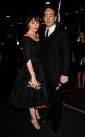 """KEELEY HAWES & MATTHEW MacFADYEN .The """"Frost/Nixon"""" World Premiere Afterparty, London Hilton Park Lane, London, England, October 15th 2008..full length black dress pointy shoes fringe clutch bag purse couple.CAP/CAN.©Can Nguyen/Capital Pictures"""