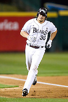 Luke Voit (30) of the Missouri State Bears rounds third base after hitting a home run during a game against the Purdue Boilermakers at Hammons Field on March 13, 2012 in Springfield, Missouri. (David Welker / Four Seam Images)