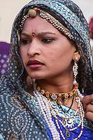 Jaipur, Rajasthan, India.  Rajasthani Woman with Necklaces, Bindi, and Headscarf.
