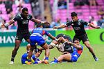 David Afamasaga of Samoa (R) tackles Luke Masirewa of New Zealand (C) during the HSBC Hong Kong Sevens 2018 match between New Zealand and Samoa on April 7, 2018 in Hong Kong, Hong Kong. Photo by Marcio Rodrigo Machado / Power Sport Images