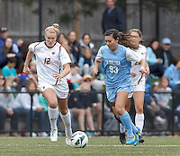 University of North Carolina midfielder Brooke Elby (93) brings the ball forward as Boston College midfielder Jana Jeffrey (12) closes.  University of North Carolina (blue) defeated Boston College (white), 1-0, at Newton Campus Field, on October 13, 2013.