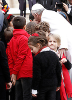 Papa Francesco saluta i bambini del coro del cantante Teddy Reno al termine dell'udienza generale del mercoledi' in Piazza San Pietro, Citta' del Vaticano, 16 dicembre 2015.<br /> Pope Francis greets greets children of Italian singer Teddy Renos choir at the end of his weekly general audience in St. Peter's Square at the Vatican, 16 December 2015.<br /> UPDATE IMAGES PRESS/Isabella Bonotto<br /> <br /> STRICTLY ONLY FOR EDITORIAL USE<br /> <br /> *** ITALY AND GERMANY OUT ***