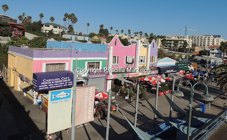 Santa Monica, California - September 23, 2012:  Brightly-colored buildings flank the Santa Monica Pier.
