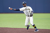 Michigan Wolverines second baseman Ako Thomas (4) makes a throw to first base against the Indiana State Sycamores on April 10, 2019 in the NCAA baseball game at Ray Fisher Stadium in Ann Arbor, Michigan. Michigan defeated Indiana State 6-4. (Andrew Woolley/Four Seam Images)